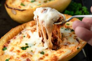 A cheesy fork pull of Lasagna Baked Spaghetti Squash
